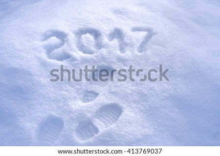 New Year 2017 greeting, footprints in snow, new year 2017, 2017 greeting card - stock photo