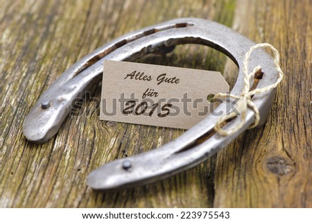 new year 2015 greetings in german language - Alles Gute - good luck - with horseshoe as talisman  - stock photo