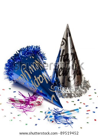 New year hats and party horn blowers with colorful confetti for holiday decoration. - stock photo