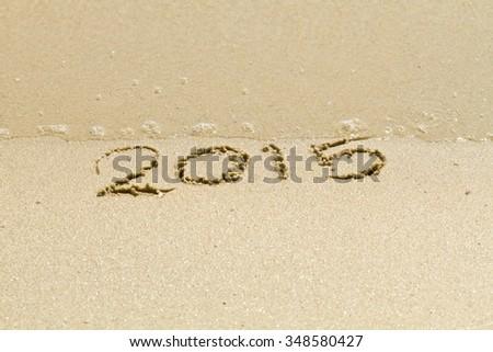 New Year,Inscription 2015 on a beach sand - stock photo