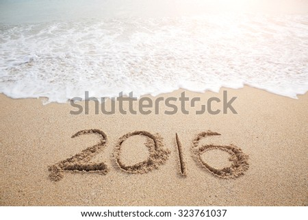 New Year 2016 is coming concept - inscription 2016 on a beach sand - stock photo