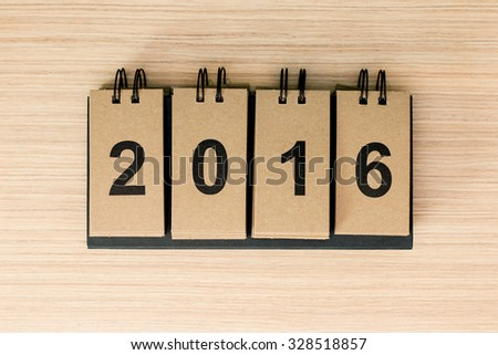 New Year 2016 is coming concept. The word 2016 on wooden background. - stock photo