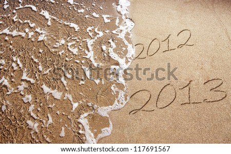 New Year 2013 is coming - numbers written in sand on exotic beach - stock photo