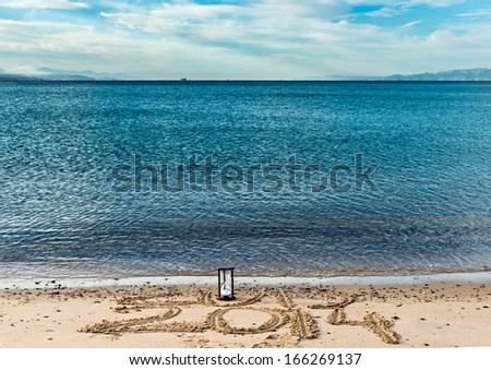 New year is coming to the sandy beach of Eilat - famous Israeli resort city located on the Red Sea - stock photo