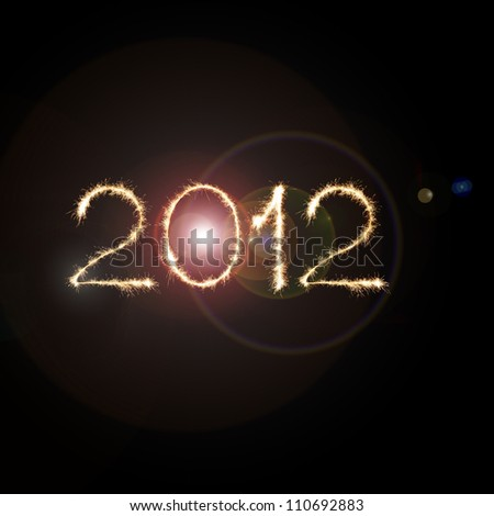 New Year 2012 made from the light streaks of moving sparklers in space - stock photo