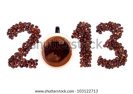 New Year 2013 made of coffee beans and cup on the white background - stock photo