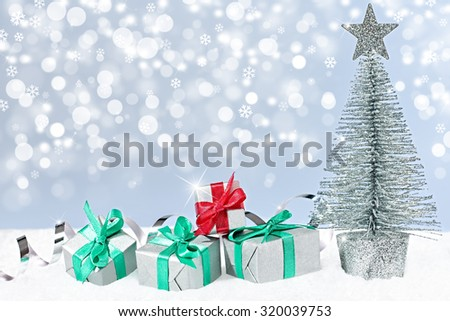 New Year 2016. Merry Christmas. Party festive decoration, Christmas tree and presents, serpentine, snowflakes, snow. Happy holiday. Vivid greeting card multicolored gift boxes, green red silver - stock photo