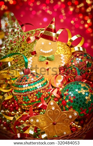 New Year 2016. Merry Christmas. Party festive decoration, gingerbread balls stars serpentine, in basket, handmade, bokeh. Happy holiday. Vivid greeting card, multicolored, green red gold, copyspace. - stock photo