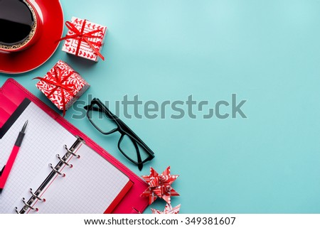 new year note and blank colorful paper notebook at office table, new year resolution concepts - stock photo