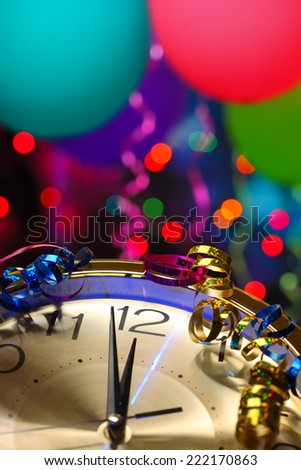 New year party decoration with balloons and clock close to midnight - stock photo