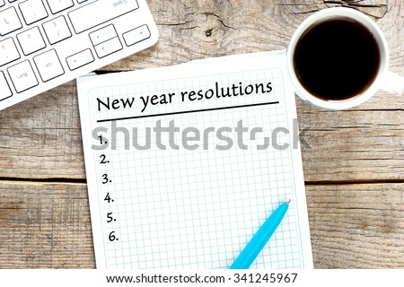 New year resolutions written on paper - stock photo
