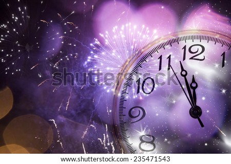 New Year's at midnight - Old clock against fireworks and holiday lights - stock photo