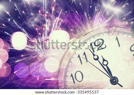 New Year's at midnight - Old clock with stars snowflakes and fireworks - stock photo