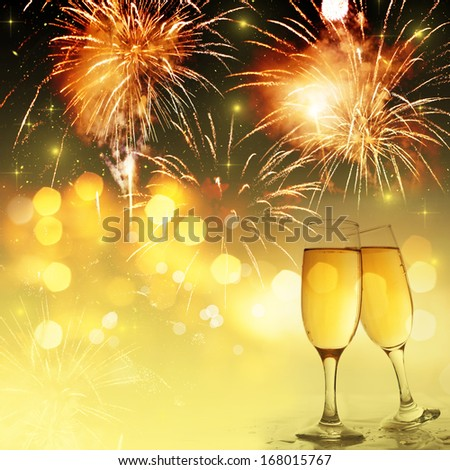 New Year's at midnight with champagne glasses and fireworks on light background - stock photo