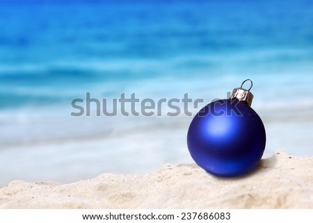 New Year's ball on a beach near the sea - stock photo