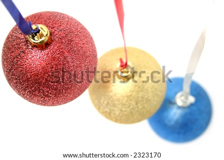 New Year's celebratory ornaments in the form of glass spheres of three colors macro - stock photo