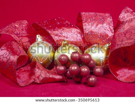 New Year's composition on a red background - ball and ribbon  - stock photo