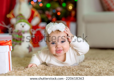 New Year's Concept. Adorable cute little girl near a Christmas tree with presents. new year - stock photo