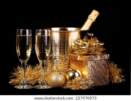 New Year's Eve. Celebration. Champagne and Presents over black background.  - stock photo