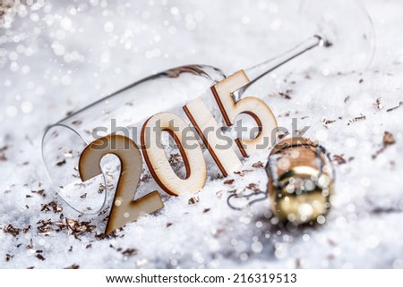 New Year's Eve concept with champagne cork and glass  - stock photo