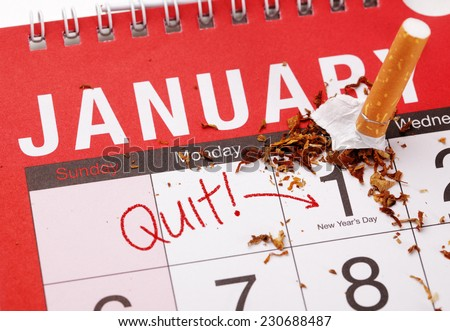 New year's resolution for quitting smoking with broken cigarette on the 1st January on a calendar - stock photo