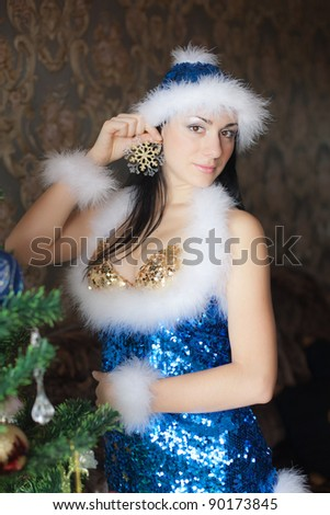 New Year's Snow Maiden. Beautiful brunette in clothes of Snow Maiden - stock photo