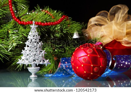 New Year's still life. Decorations and ribbons on a bright color background - stock photo