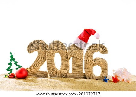 New year 2016 sign on beach sand - stock photo