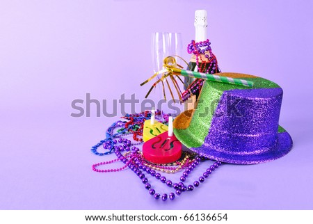 New Year 2012 still life with champagne bottle and flutes, noisemakers, hat, beads and copy space on bright light purple pink background. Studio shot. Can be cut out. - stock photo