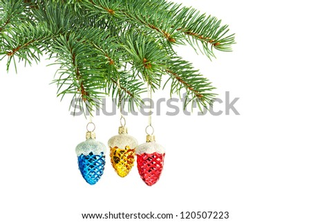 new year toys. Red, yellow and blue cones on christmas tree - stock photo