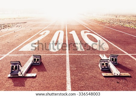 new year 2016 warm look numbers painted on a racing lane  - stock photo