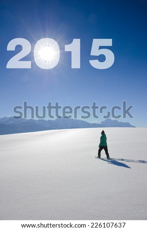new year 2015 with single hiker in snow - stock photo