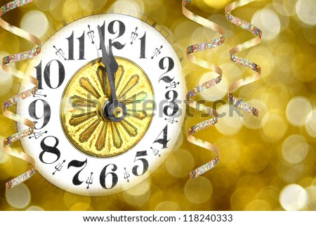 New Years Eve party - clock with streamers and abstract light background - stock photo