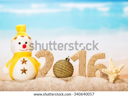"""New Years inscription """"2016"""" with a snowman on the background of the sea - stock photo"""