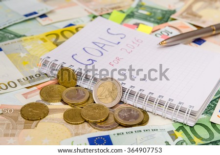 New years resolutions save money. euro background - stock photo