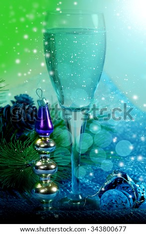 New years style life with glass of champagne in neon color light - stock photo