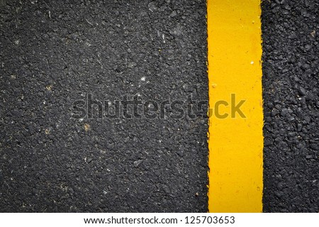 new yellow line on the road texture - stock photo