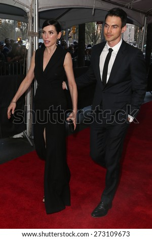 NEW YORK-APR 21: Actress Julianna Margulies (L) and husband Keith Lieberthal attend the 2015 Time 100 Gala at Frederick P. Rose Hall, Jazz at Lincoln Center on April 21, 2015 in New York City. - stock photo