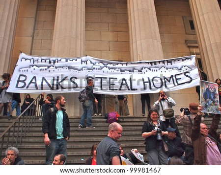 NEW YORK - APR 13: Occupy Wall Street activists hold a rally at Federal Hall April 13, 2012 in New York City, NY. Protesters continued their months-long demonstration against the financial system. - stock photo