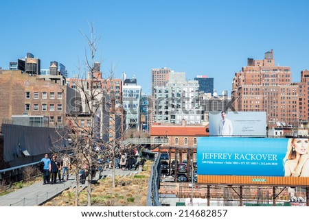 NEW YORK - APR 6:  Unidentified tourists at the High Line on Apr 6, 2014. It is a public park built on an historic freight rail line elevated above the streets on Manhattan's West Side. - stock photo