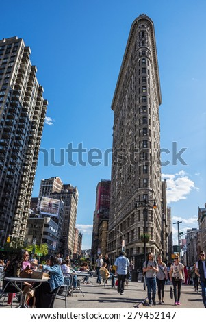 NEW YORK-APRIL 28-A view of the Flatiron Building and public space on April 28, 2015 in New York City. - stock photo