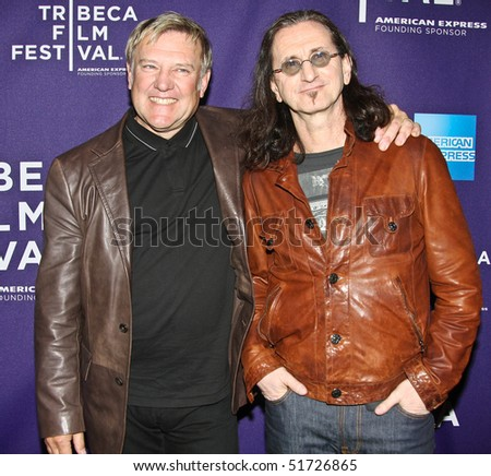 "NEW YORK - APRIL 24: Alex Lifeson (L) and Geddy Lee (R) attend the ""RUSH: Beyond the Lighted Stage"" premiere during the 2010 TriBeCa Film Festival at the School of Visual Arts Theater on April 24, 2010 in New York City. - stock photo"