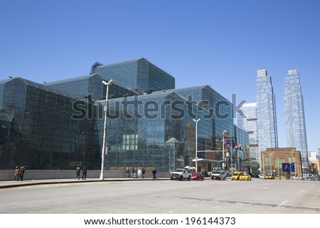 NEW YORK - APRIL 24: Javits Convention Center in Manhattan on April 24, 2014. The convention center has a total area space of 1,800, 000 square ft and has 840,000 square ft of total exhibit space  - stock photo