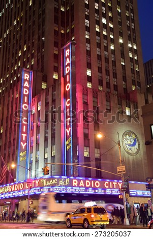 NEW YORK - APRIL 27: Night traffic speeds past landmark Radio City Music Hall in New York City on April 27, 2015. The venue is legendary in entertainment industry - stock photo