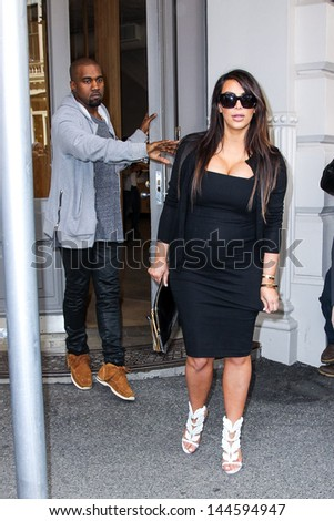 New York, April 22, 2013. Pregnant Kim Kardashian and Kanye West made a quck shopping stop at Isabel Marant store in SoHo in NYC. - stock photo