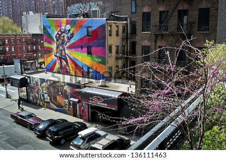NEW YORK - APRIL 22: Scenic views along the High Line on April 22 2013. The High Line is a popular linear park built on the elevated train tracks above Tenth Ave in New York City. - stock photo