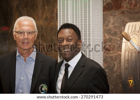 NEW YORK - APRIL 17, 2015: Soccer legends Pele and Franz Beckenbauer at the ceremony to light the Empire State Building Cosmos Green to launch and celebrate the start of the teams 2015 spring season. - stock photo
