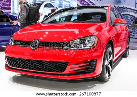 NEW YORK - APRIL 1: Volkswagen exhibit before Volkswagen Golf GTI at the 2015 New York International Auto Show during Press day,  public show is running from April 3-12, 2015 in New York, NY. - stock photo