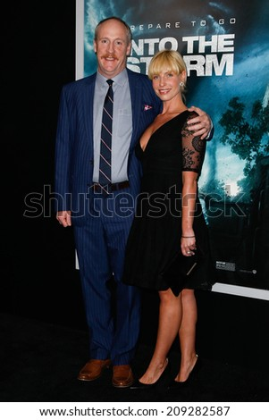 "NEW YORK-AUG 4: Actor Matt Walsh (L) and wife Morgan Walsh attend the ""Into The Storm"" premiere at the AMC Lincoln Square Theater on August 4, 2014 in New York City. - stock photo"