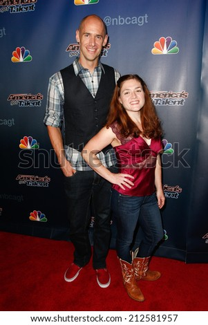 NEW YORK-AUG 20: Andy Cook (L) and Abigail Baird of Aerial Animation attend the post-show red carpet for 'America's Got Talent' Season 9 at Radio City Music Hall on August 20, 2014 in New York City. - stock photo